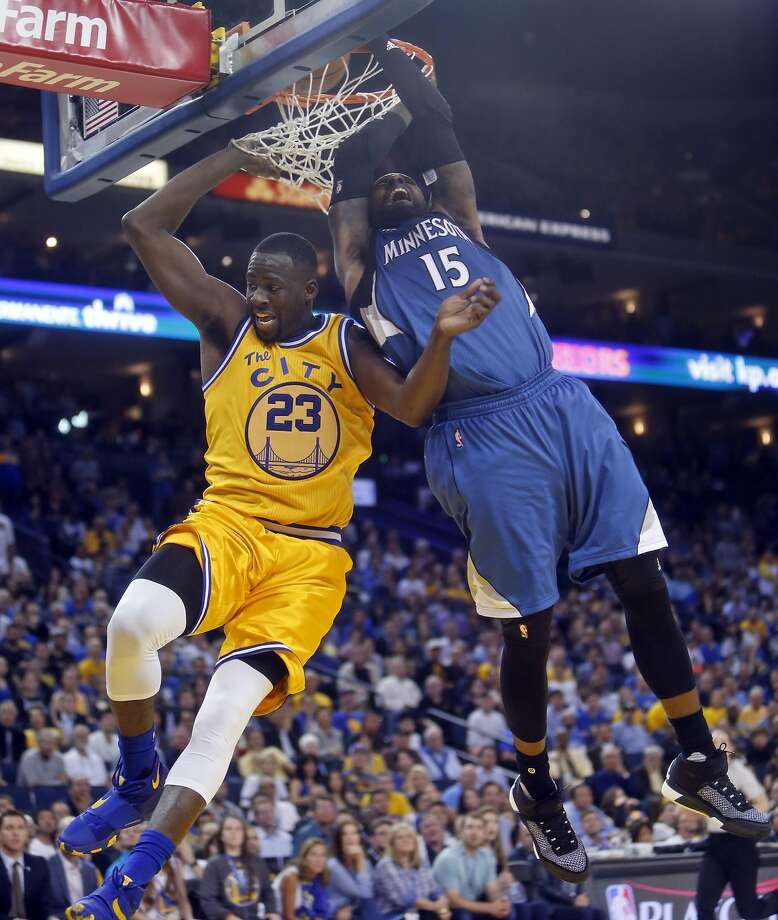 Draymond Green fouls out as he collides with the Timberwolves' Shabazz Muhammad in overtime during Warriors' 124-117 loss at the Oracle Arena. Photo: Scott Strazzante, The Chronicle