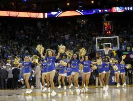 Golden State Warriors' cheerleaders during time out in Minnesota Timberwolves' 124-117 overtime win in NBA game at Oracle Arena in Oakland, Calif., on Wednesday, April 5, 2016.