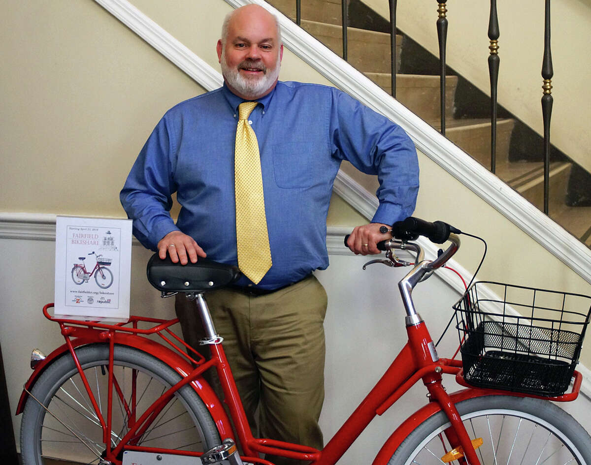 Health Director Sands Cleary poses with one of the 10 bikes that will be part of the free Fairfield BikeShare program that will start on April 21.