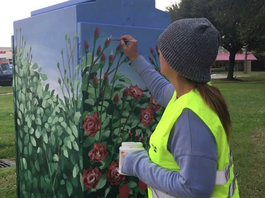 Anat Ronan, the artist, painting the utility box at Paseo Park in Bellaire. Photo: Terry Leavitt-Chavez