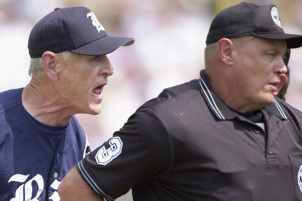 Home plate umpire Tony Maners, right, turns away after ejecting Rice coach Wayne Graham, left, in the sixth inning of the second game of the College World Series best-of-three championship series Sunday, June 22, 2003, in Omaha, Neb. Graham was ejected after he disputed a strike call on Rice's Paul Janish.