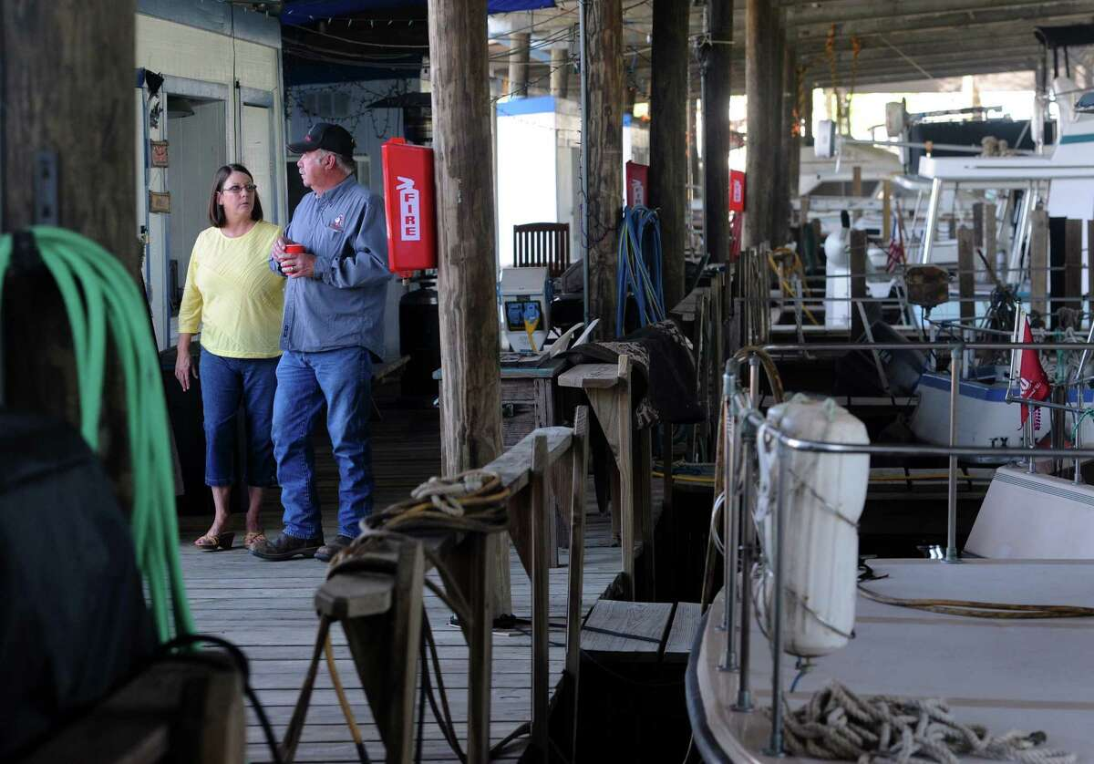 Talmadge Magee and Kathy Magee walk through the Beaumont Yacht Club on Tuesday. The City of Beaumont sold the property for $1,475,000 to USA Self Storage Inc. during a council meeting earlier that day. Photo taken Tuesday, April 5, 2016 Guiseppe Barranco/The Enterprise