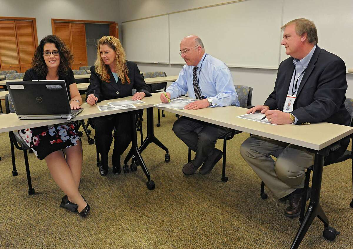 From left, Kathleen Skeals, assistant superintendent for curriculum and instruction, Jenna Bongermino, human resources director, Joseph Corr, district superintendent, and William Furlong, assistant superintendent for business work in the North Colonie Central Schools district offices on Wednesday, March 16, 2016 in Colonie, N.Y. (Lori Van Buren / Times Union)