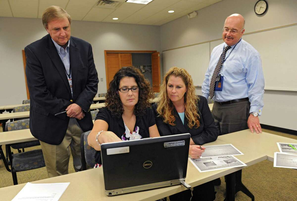 From left, William Furlong, assistant superintendent for business, Kathleen Skeals, assistant superintendent for curriculum and instruction, Jenna Bongermino, human resources director, ,and Joseph Corr, district superintendent, work in the North Colonie Central Schools district offices on Wednesday, March 16, 2016 in Colonie, N.Y. (Lori Van Buren / Times Union)