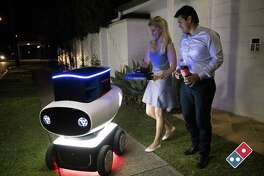 "An undated handout photo received on March 18, 2016, shows fast food giant Domino's new trial pizza delivery robot in New Zealand, describing the hi-tech, driverless units as a world first.  In a move enthusiastically backed by the New Zealand government, Domino's said it was working with authorities on plans to roll out its DRU (Domino's Robotic Unit). The four-wheeler, developed in Australia, is just under a metre (three foot) high and contains a heated compartment that can hold up to 10 pizzas. / AFP PHOTO / str / RESTRICTED TO EDITORIAL USE - MANDATORY CREDIT ""AFP PHOTO / BMI"" - NO MARKETING NO ADVERTISING CAMPAIGNS - DISTRIBUTED AS A SERVICE TO CLIENTS == NO ARCHIVE STR/AFP/Getty Images"