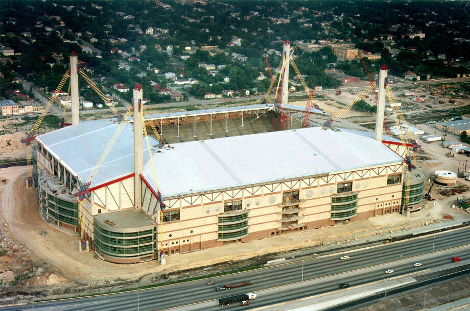 1. In 1993, the Alamodome was S.A.'s shiny, new toyThe 'dome opened in 1993 and was the Spurs' home during the team's s 1999 championship season, but it never was truly intended to permanently house a professional sports franchise. The Alamodome is shown in a 1992 file photo, before its roof was completed. Photo: JOHN DAVENPORT, FILE / SAN ANTONIO EXPRESS-NEWS