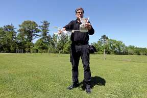 Drone videographer and photographer Coleman Jennings calibrates his drone before Taylor Jolly and Amy Stark's wedding held Saturday April 2, 2016 at the Ranch House Chapel & Lodge in Montgomery, TX.
