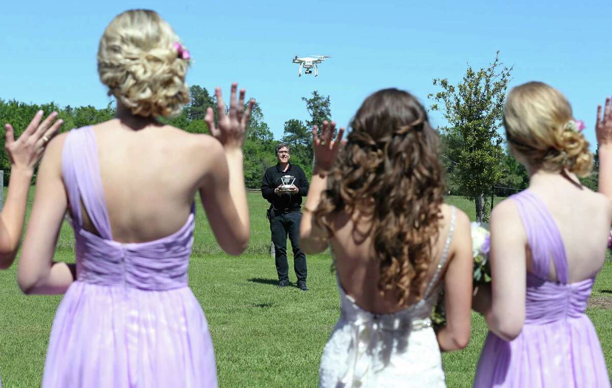 Drone videographer and photographer Coleman Jennings flies his drone for video footage before Taylor Jolly and Amy Stark's wedding held Saturday April 2, 2016 at the Ranch House Chapel & Lodge in Montgomery, TX