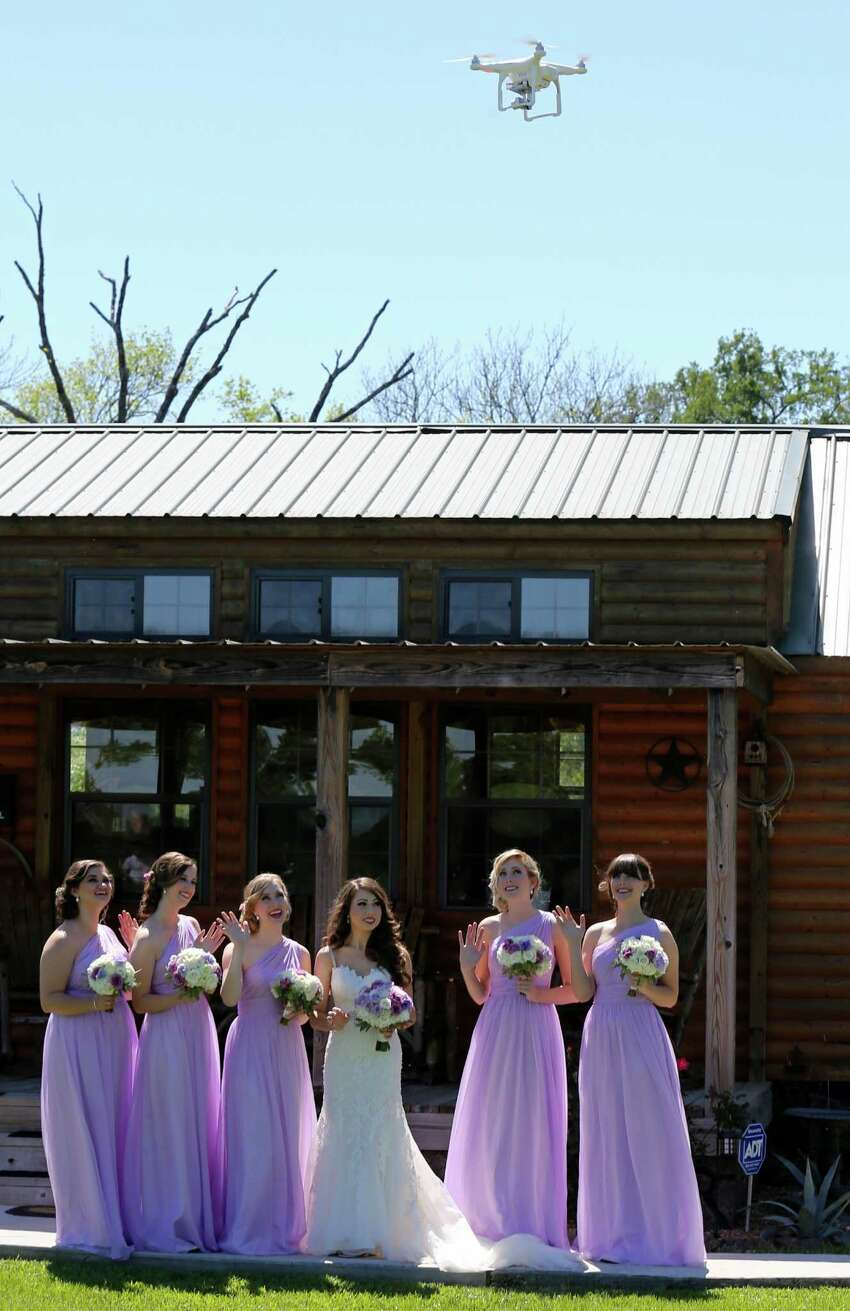 Lauren Elander (from left), Morgan Mobley, Shannon Smith, Amy Stark, Ellie Herring, and Nicole Enas pose for drone footage by drone videographer and photographer Coleman Jennings before Taylor Jolly and Amy Stark's wedding held Saturday April 2, 2016 at the Ranch House Chapel & Lodge in Montgomery, TX