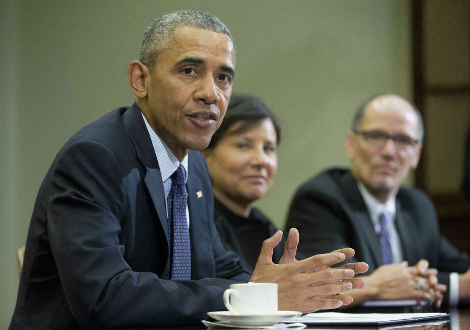 President Barack Obama, with Commerce Secretary Penny Pritzker, center, and Labor Secretary Thomas E. Perez, speaks during a meeting with members of his economic team in the Roosevelt Room of the White House this month. A ruling rules issued by the Labor Department on Wednesday could shake up how Americans' retirement investments are handled by brokers. Photo: Associated Press / AP