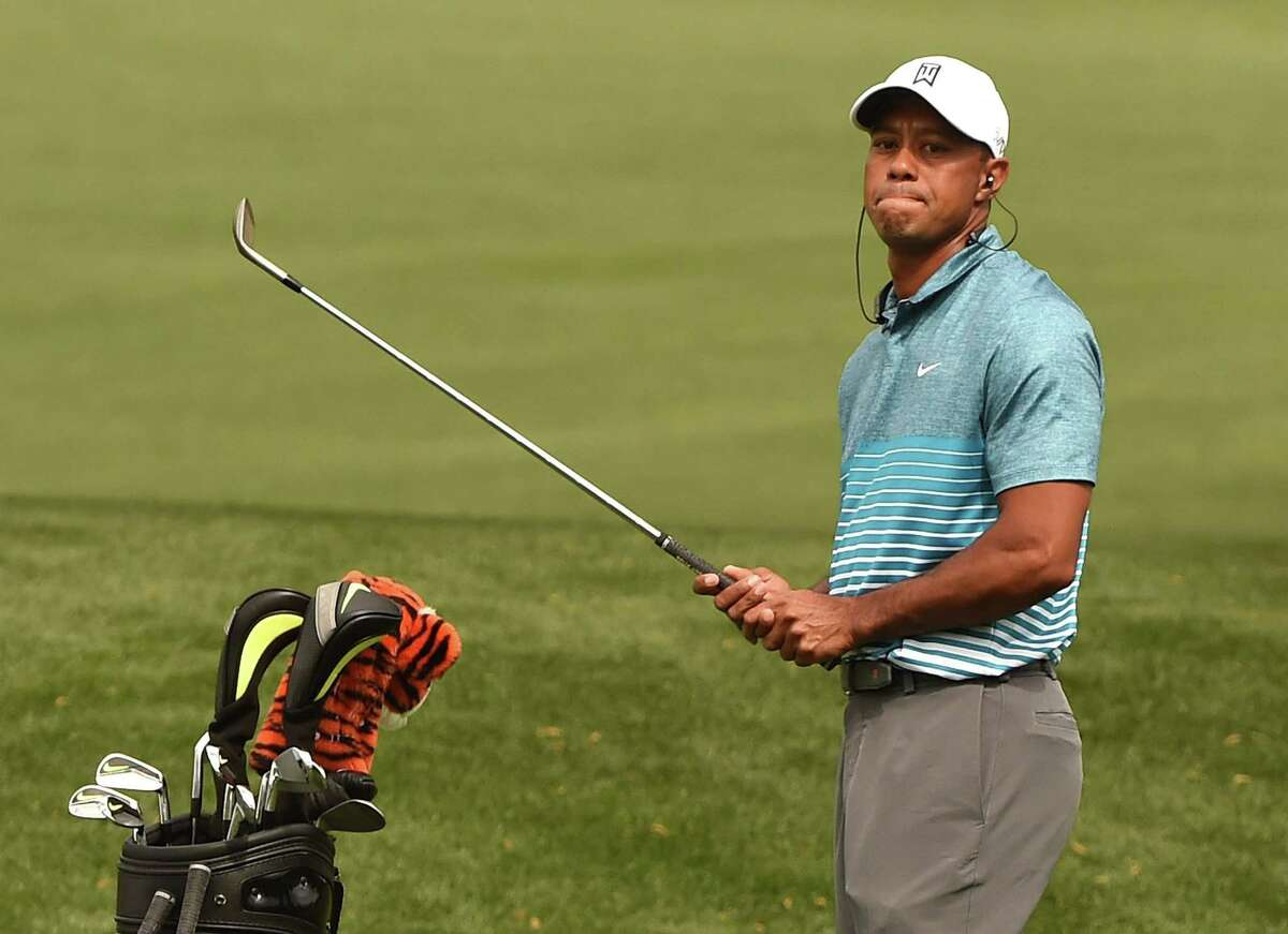 (FILES): This file photo taken on April 06, 2015 shows Tiger Woods of the US on the practice range at Augusta National Golf Club in Augusta, Georgia ahead of the 2015 Masters Golf Tournament. Former world number one Tiger Woods confirmed April 1, 2016 he will not participate in next week's 80th Masters, saying his rehabilitation from back surgery has not progressed far enough to allow him to compete. The 14-time major champion, a four-time Masters winner, has not played a PGA event since last August. Since then, he underwent back surgery and a follow-up procedure to ease discomfort from a pinched nerve. / AFP PHOTO / TIMOTHY A. CLARYTIMOTHY A. CLARY/AFP/Getty Images ORG XMIT: Tiger Woo