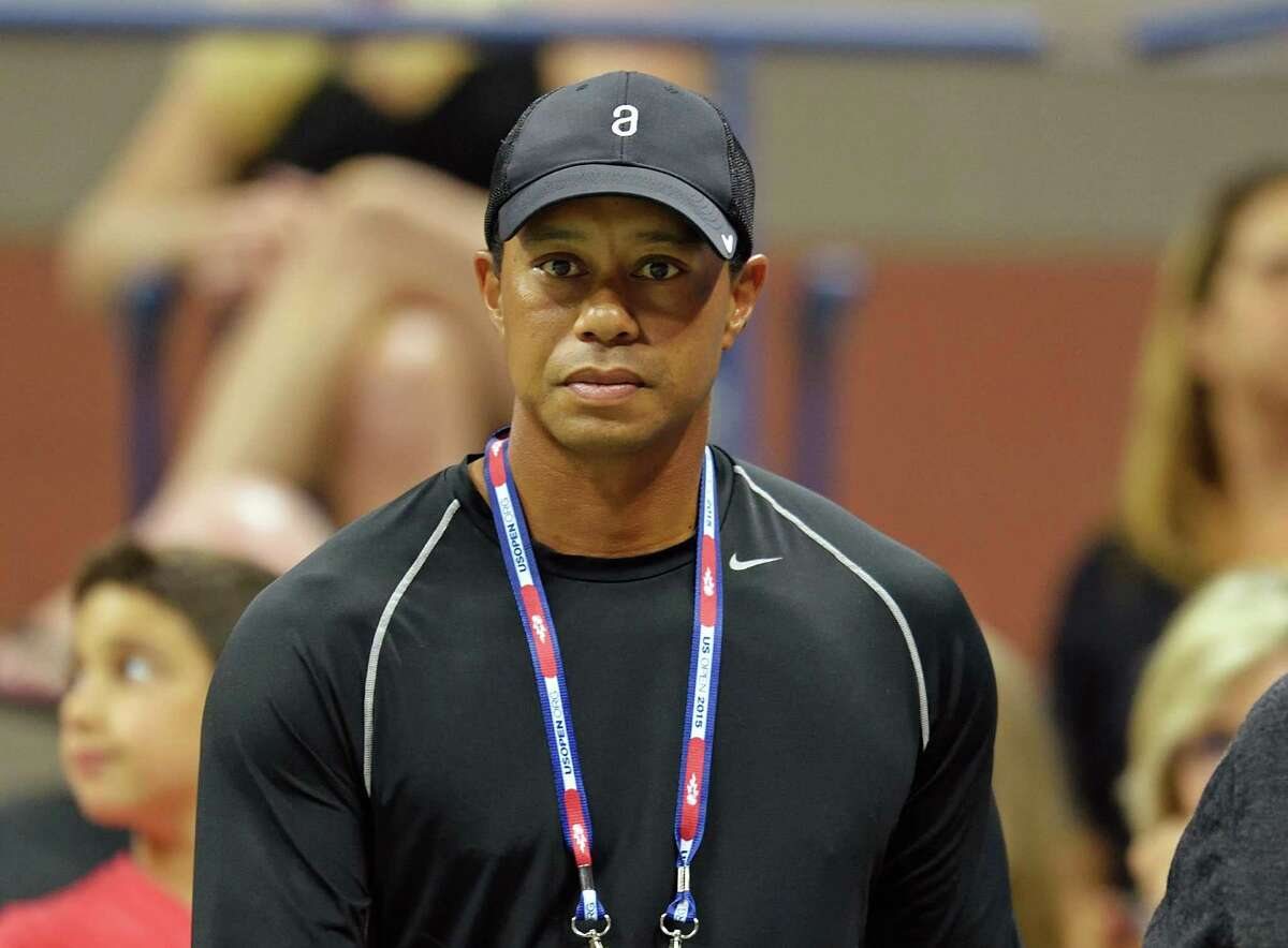 With AFP Story by Jim SLATER: Golf-USPGA-Woods (FILES): This September 4, 2015 file photo shows Tiger Woods attending the match between Rafael Nadal of Spain and Fabio Fognini of Italy during their 2015 US Open third round men's singles match at the USTA Billie Jean King National Tennis Center in New York. Tiger Woods reaches his 40th birthday on Wednesday, December 30, 2015m, still recovering from a third back operation with no timetable for another golf comeback and reflective comments about ending his epic career. Former world number one Woods has 14 major titles, four shy of the all-time record set by Jack Nicklaus, and 79 PGA victories, three off the career best held by Sam Snead. AFP PHOTO / Files / DON EMMERTDON EMMERT/AFP/Getty Images ORG XMIT: Golf: Tig
