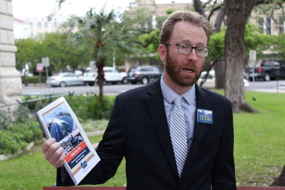 Luke Metzer, director of Environment Texas, discusses a new report Wednesday by its parent group Environment America that ranks San Antonio No. 7 for solar capacity in the U.S. Photo: Brendan Gibbons /San Antonio Express-News