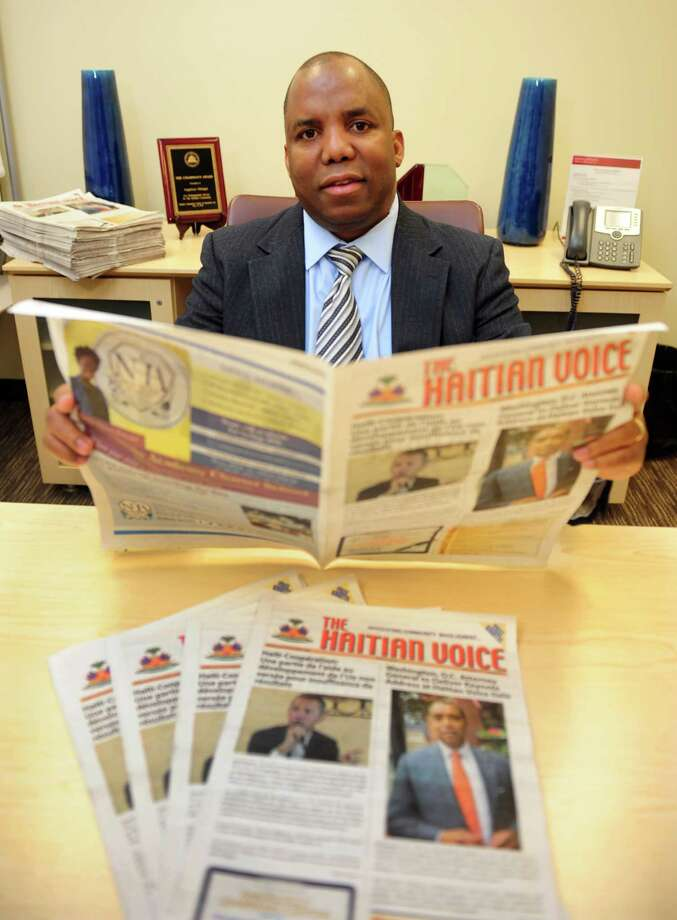Haitian Voice Publisher Angelucci Manigat Jr. poses at the newspaper's offices located inside the RBS building on Lafayette Street in Bridgeport, Conn., on Tuesday Apr. 5, 2016. For over a decade the trilingual newspaper has continued to be a mainstay within the Haitian community around the region as well as in Haiti. Photo: Christian Abraham / Hearst Connecticut Media / Connecticut Post