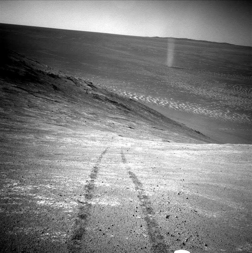 A picture of a Martian dust devil taken by NASA's Opportunity rover. (NASA) See more strange items spotted in NASA Mars photos ...