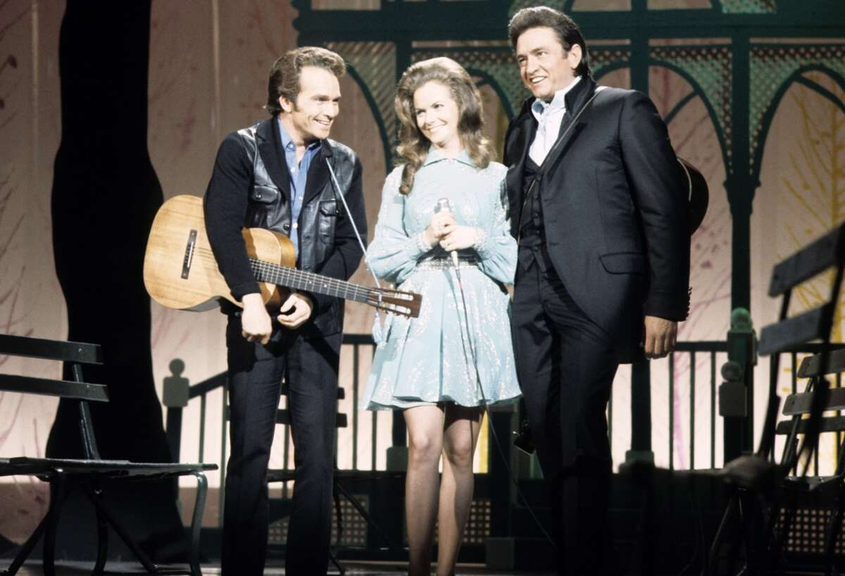 Merle Haggard, Jeannie C. Riley and Johnny Cash on