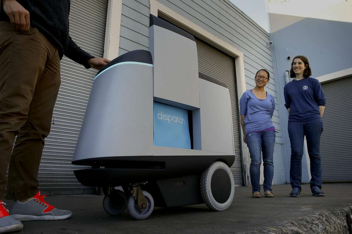 (l to r) CTO Uriah Baalke, CPO Sonia Jin and CEO Stav Braun all co-founders, display their delivery robot Dispatch that can transport up to 100 pounds of goods, seen at their headquarters in South San Francisco on Wed. April 6, 2016.