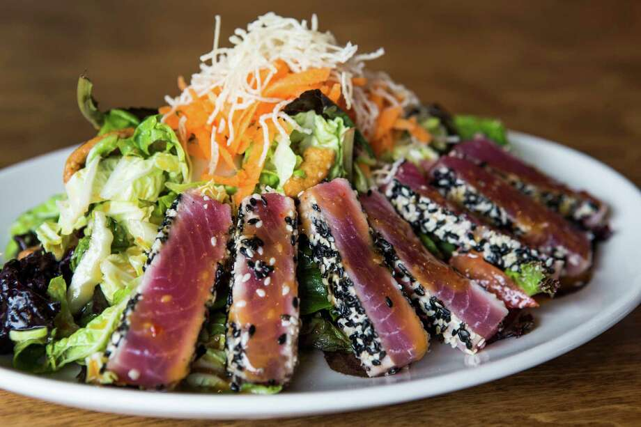 The sesame ginger Ahi tuna salad is shown at Restless Palate in Katy. Photo: Brett Coomer, Houston Chronicle / © 2016 Houston Chronicle