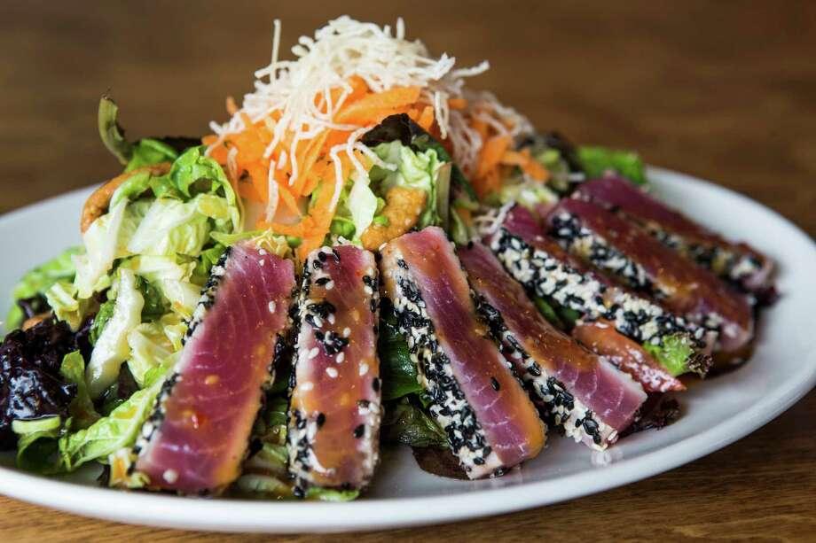 The sesame ginger Ahi tuna salad is shown at Restless Palate in Katy. Photo: Brett Coomer, Houston Chronicle / © 2016 Houston Chronicle