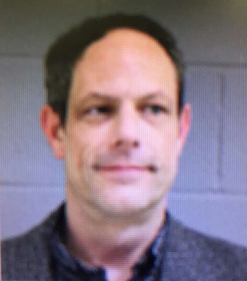 Newtown teacher arrested for having gun at school
