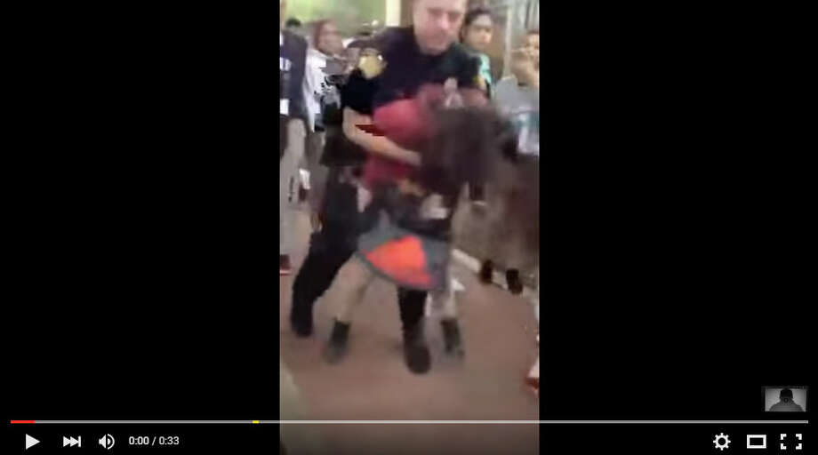 San Antonio Independent School District is investigating a possible case of excessive force after this video was published online appearing to show an incident at Rhodes Middle School. https://www.youtube.com/watch?v=__GRdC_J_ng Photo: YouTube/Ghost-0