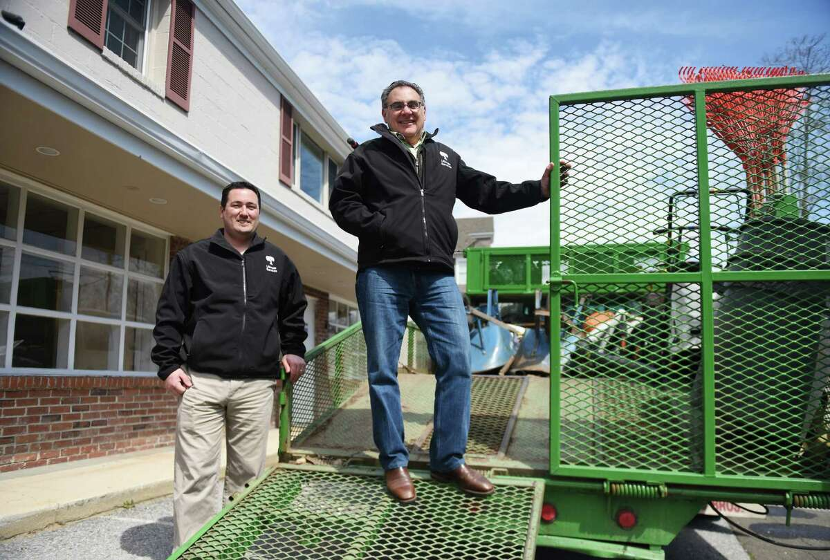 Sales and Business Developer Marco Vitiello, left, and President John G. Chiarella, Jr. pose by a company truck at the new Ultimate Services Professional Grounds Management in Greenwich, Conn. Wednesday, April 6, 2016. The new 4,000-5,000 sq. ft. space will help better serve the company's primarily-Greenwich client base.