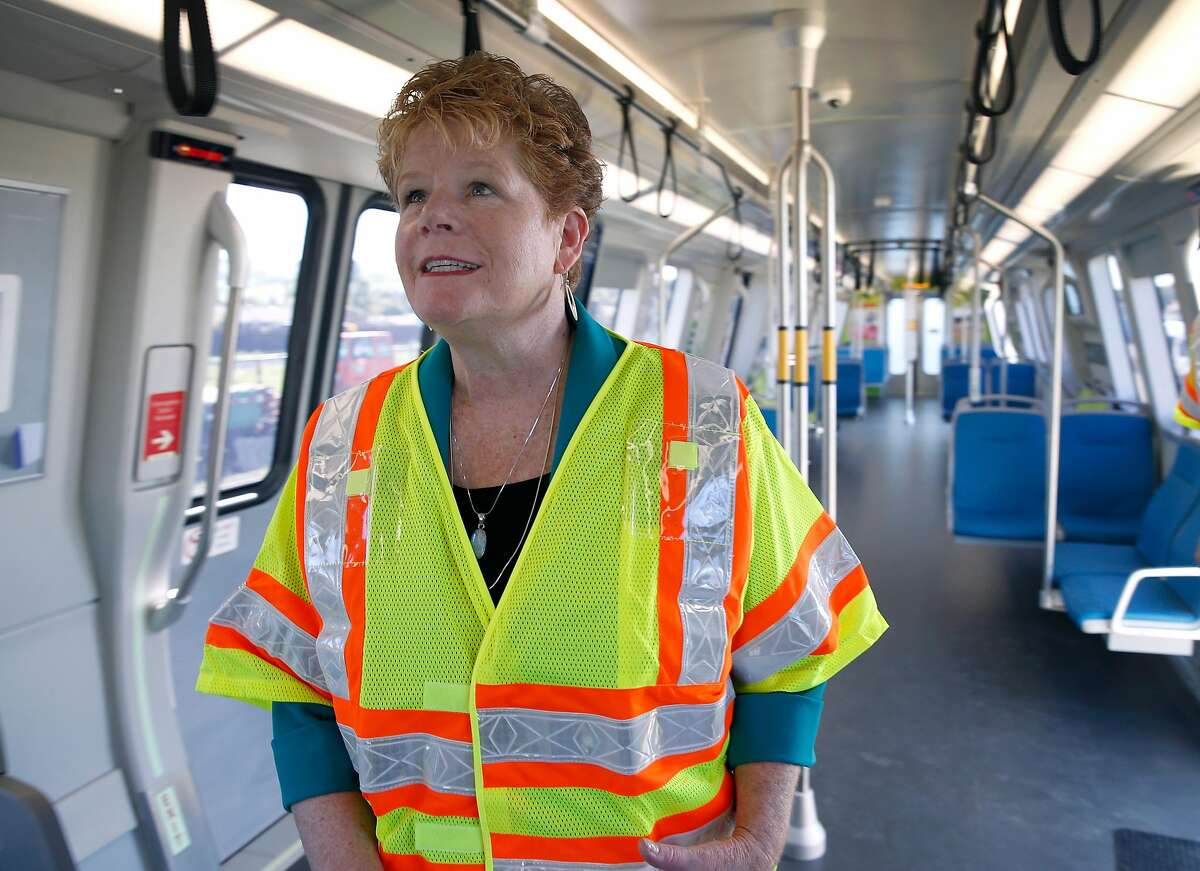BART General Manager Grace Crunican walks through the first of the transit agency's new fleet of 775 cars unveiled at the testing facility in Hayward in 2016. Crunican announced she will retire in July.