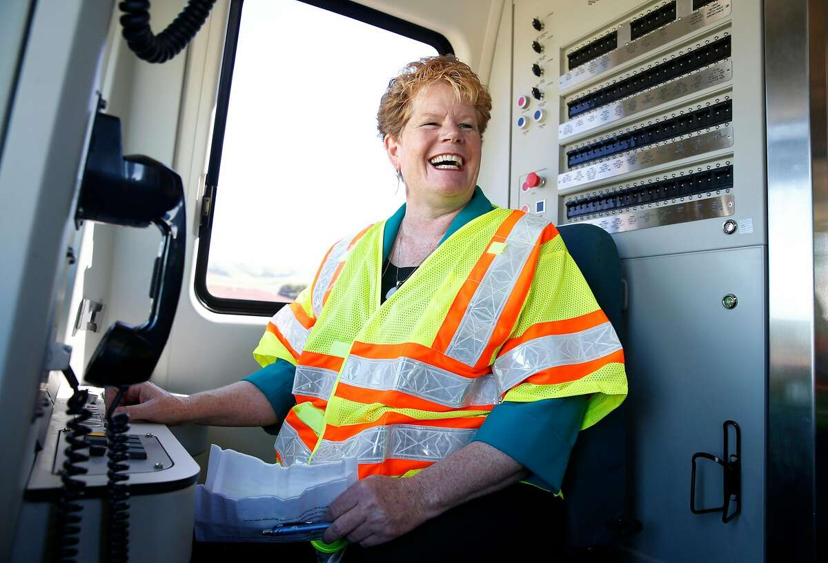 BART General Manager Grace Crunican sits at the controls in the first of the transit agency's new fleet of 775 cars unveiled at the testing facility in Hayward, Calif. on Wednesday, April 6, 2016. BART is targeting revenue service to begin with a complete train of new cars by December 2016, once a rigorous testing phase is completed.