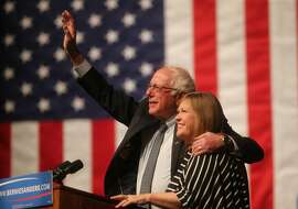 Democratic presidential candidate Sen. Bernie Sanders, I-Vt., waves to the crowd with his wife, Jane Sanders, by his side during a campaign rally Tuesday evening in the Arts and Sciences Auditorium at the University of Wyoming campus on April 5, 2016, in Laramie, Wyo. Sanders won the Democratic presidential primary in Wisconsin Tuesday. (Blaine McCartney/The Wyoming Tribune Eagle via AP) MANDATORY CREDIT