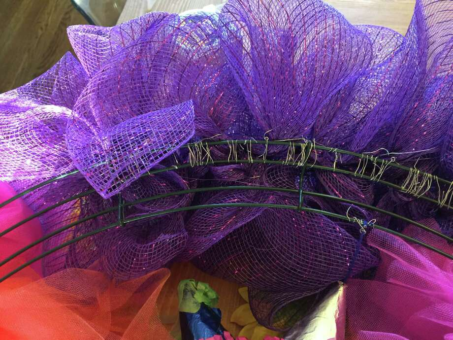 This is what the back of the wreath looks like after the decorative mesh is attached. Photo: Emily Spicer /San Antonio Express-News