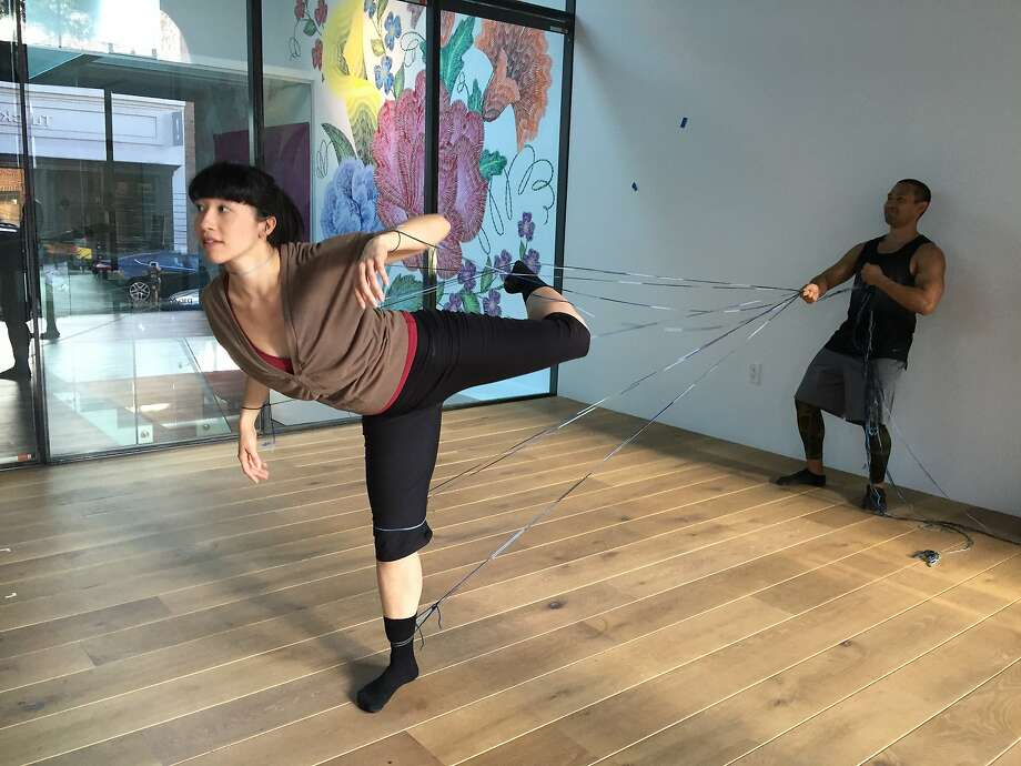 Linked by yarn, Katerina Wong and Kelly Del Rosario rehearse a section of RAWdance's site-specific work at 836M Gallery. Photo: Claudia Bauer