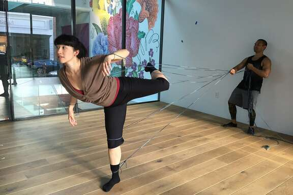 Linked by yarn, Katerina Wong and Kelly Del Rosario rehearse a section of RAWdance�s site-specific work at 836M Gallery. The ongoing project culminates in a final showing on June 3.  Photo by Claudia Bauer