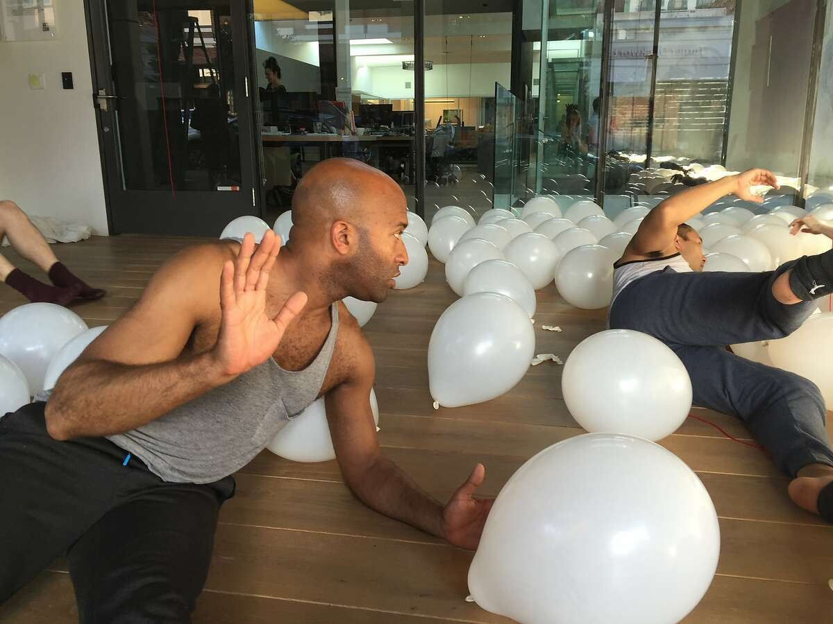 Corey Brady and Kelly Del Rosario work out a dance phrase in a field of balloons. RAWdance�s site-specific rehearsals continue at 836M Gallery through June 3. Photo by Claudia Bauer