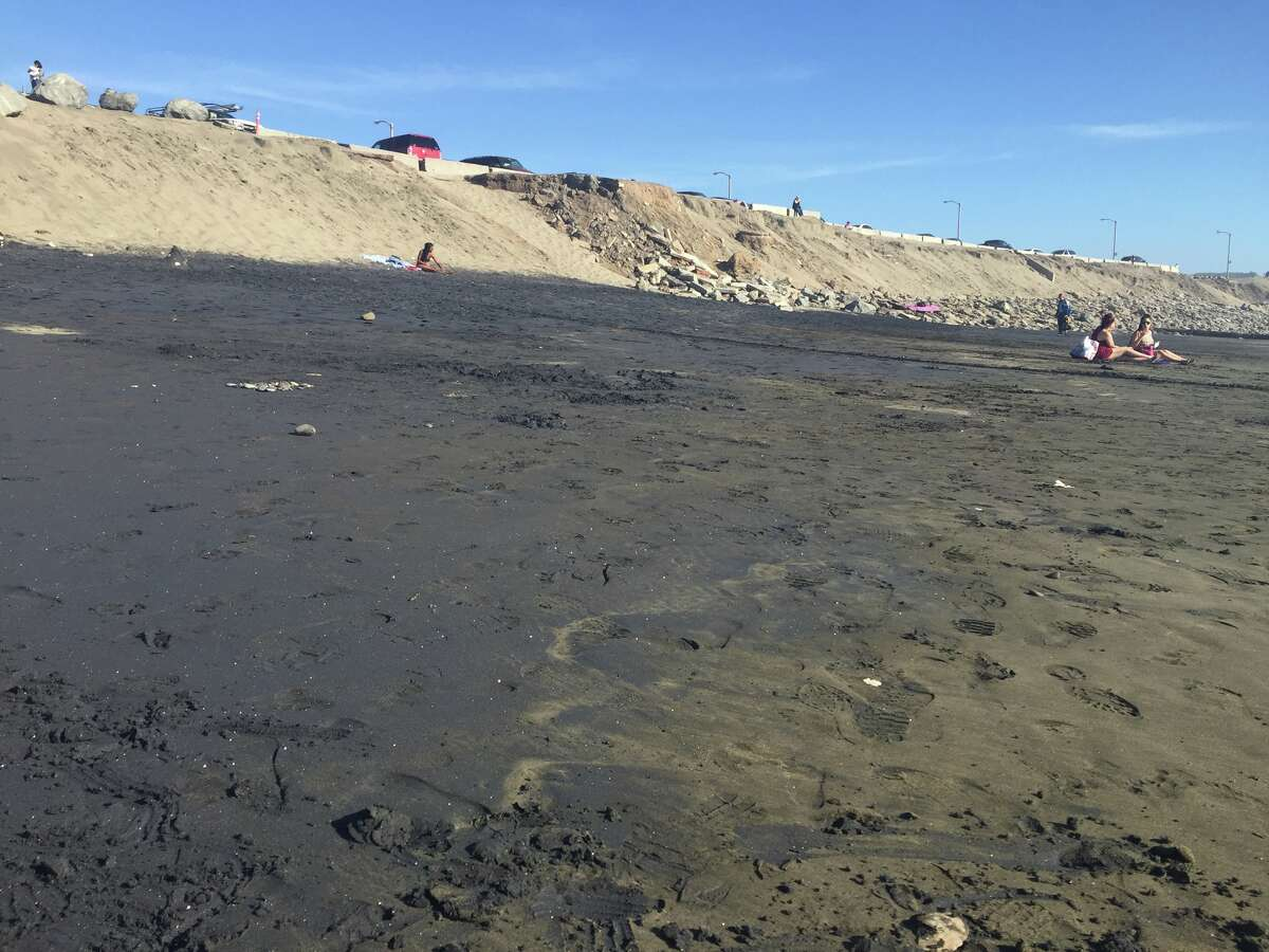 Black magnetite sand covered parts of Ocean Beach on April 5, 2016.