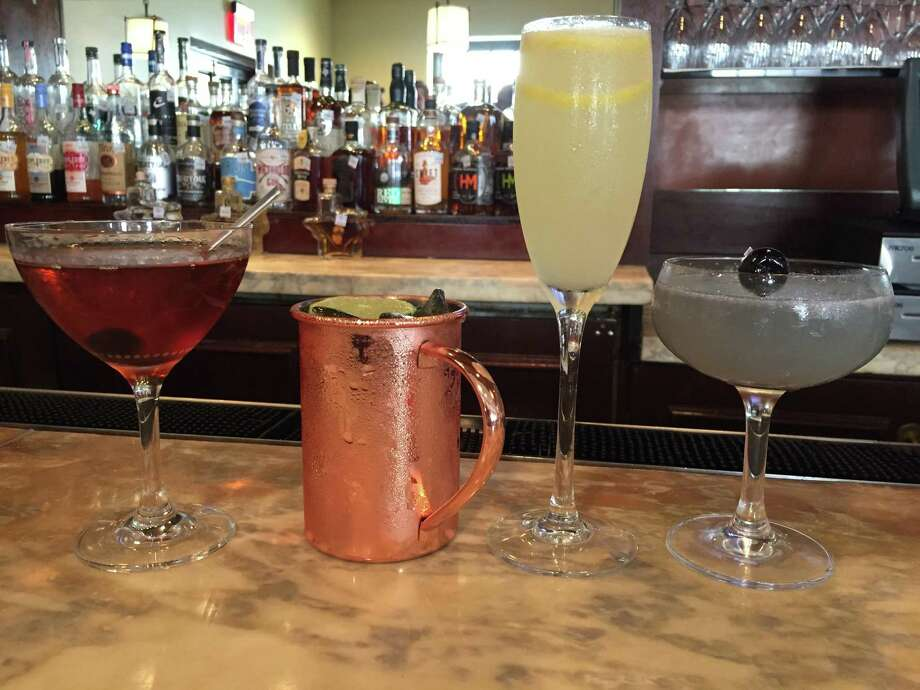 From left: Manhattan, Moscow Mule, French 75 and Aviation cocktails at El Colegio bar at Omni Mansion del Rio Hotel Photo: Edmund Tijerina