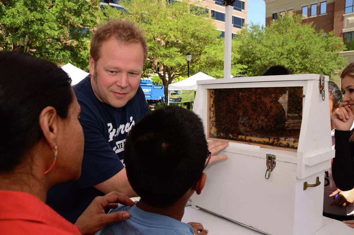 Sugar Land Town Square will host the city's Earth Day Celebration from 1-5 p.m. April 16. Above, Karl Appleton with the Fort Bend Bee Keepers shows Geetha Prabhu and her son Vikrom Prabhu the purpose of bees at an earlier Earth Day.