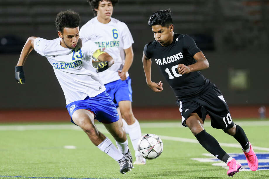 Southwest's J.P. Ortiz (right) drives the ball against Clemens' Alexzander Shaw as Antonio Salazar looks on during their second round playoff game April 1. Photo: Marvin Pfeiffer /San Antonio Express-News / Express-News 2016