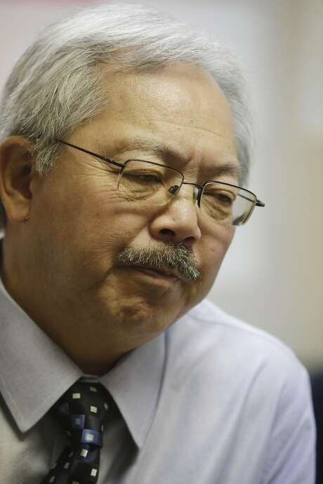 Mayor Ed Lee talks with  residents in an office at the Pier 80 homeless shelter where he let them know that Pier 80 would remain open until at least July 1 on Wednesday, April 6, 2016 in San Francisco, California. Photo: Lea Suzuki, The Chronicle