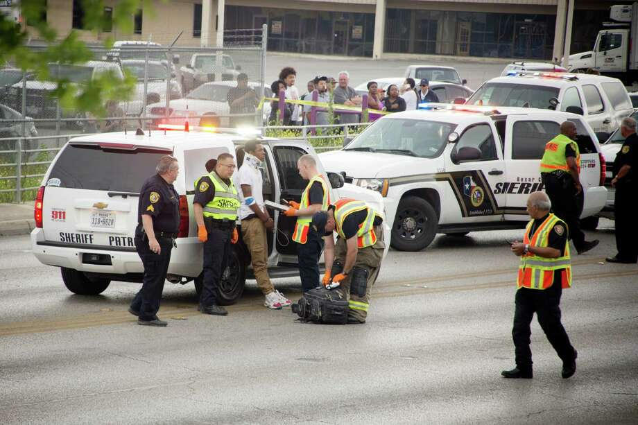 Bexar  County Sheriff's Office deputies investigate the scene of a fatal crash that happened at O'Connor and Nacogdoches. A driver who led police on a 22-minute chase across the Northeast Side with three passengers, including a pregnant teen, died in a violent rollover crash Wednesday morning.  All four individuals inside the truck were in their late teens to early 20s. Photo: Nain Leon