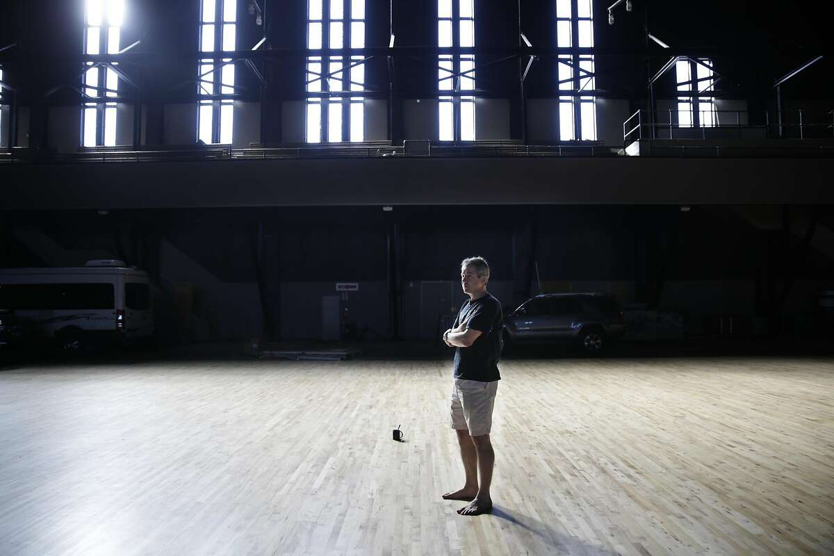 Peter Acworth, owner of the Armory and Kink.com, poses for a portrait in the Drill Court at the Armory on Monday, October 12, 2015 in San Francisco, Calif.