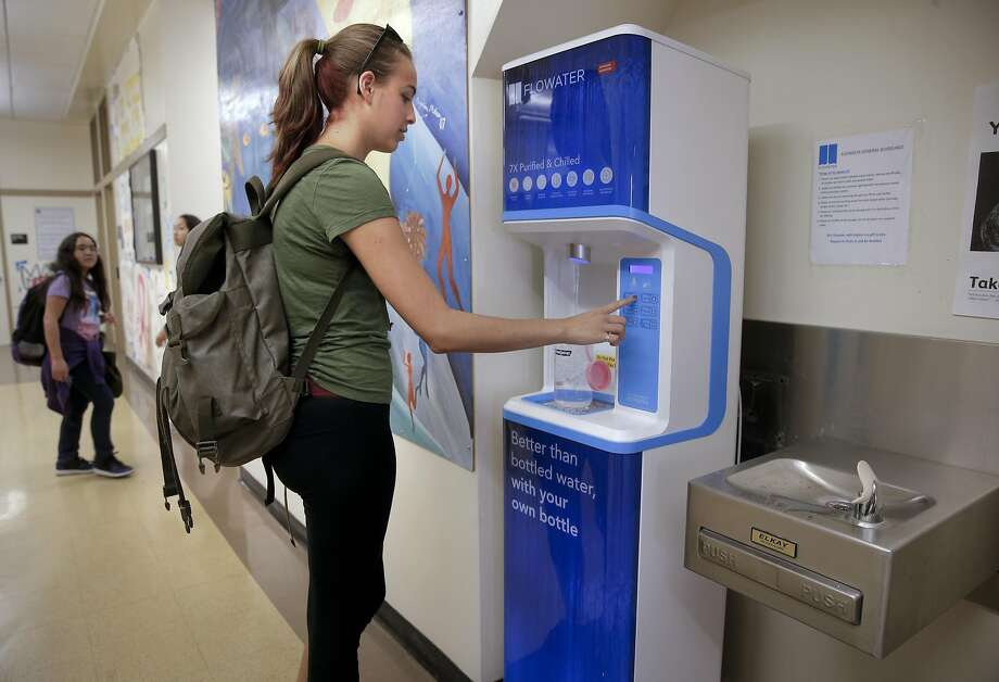Senior Mina Tobias refills her bottle at the FloWater station during lunch break at San Mateo High School in San Mateo. For many students, the dispensers are easier to use than fountains. Photo: Michael Macor, The Chronicle