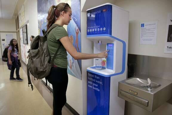 Senior Mina Tobias, refills her bottle at the FloWater station during lunch break at San Mateo High School in San Mateo, California on Wed. April 6, 2016.  The San Mateo Union High district has purchased new water refilling stations from Flowater, a device that filters water like seven times,a process that wastes water and is not cheap.