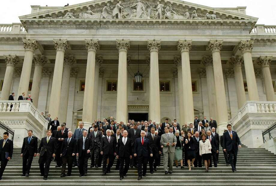 Members of the House and Senate walk outside the House of Representatives for a news conference last week. Sure, U.S. senators and representatives are, technically speaking, employed. But it's hard to argue that they're working. Photo: Chip Somodevilla /Getty Images / 2009 Getty Images
