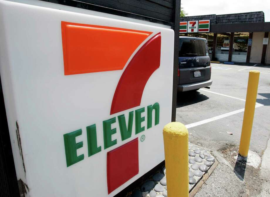 A 7-Eleven with a Citibank ATM inside is shown in Palo Alto, Calif., Tuesday, July 1, 2008.  A security breach in Citibank ATMs at 7-Eleven stores has led to hundreds of thousands of dollars in fraudulent cash withdrawals from hijacked accounts and a criminal indictment that points to an international crime ring. Especially troubling is that the ring apparently found a new way to grab PINs, the most sensitive part of a consumer's banking record. (AP Photo/Paul Sakuma) Photo: Paul Sakuma / AP / AP