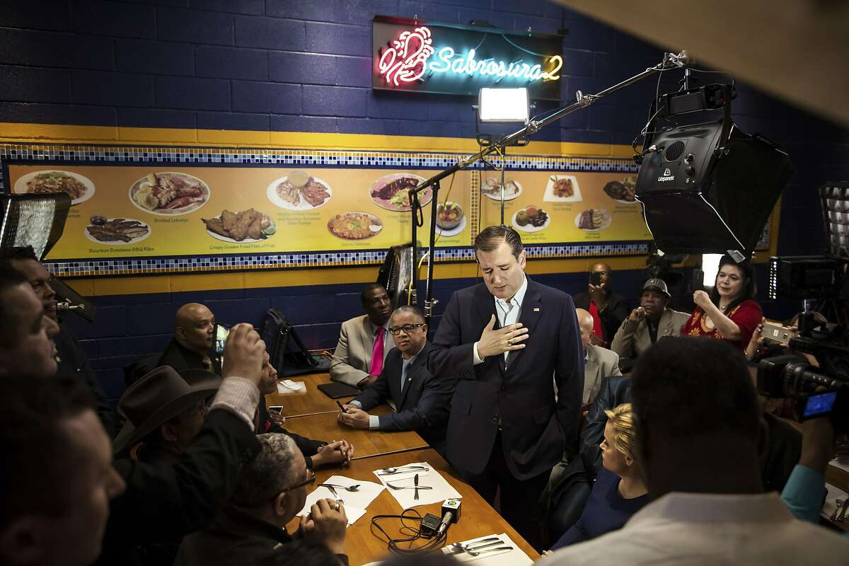 Sen. Ted Cruz of Texas, a Republican presidential hopeful, speaks with a group of supporters during a campaign visit at the Sabrosura 2 restaurant in the Bronx borough of New York, April 6, 2016. The state holds its presidential primaries on April 19. (Todd Heisler/The New York Times)