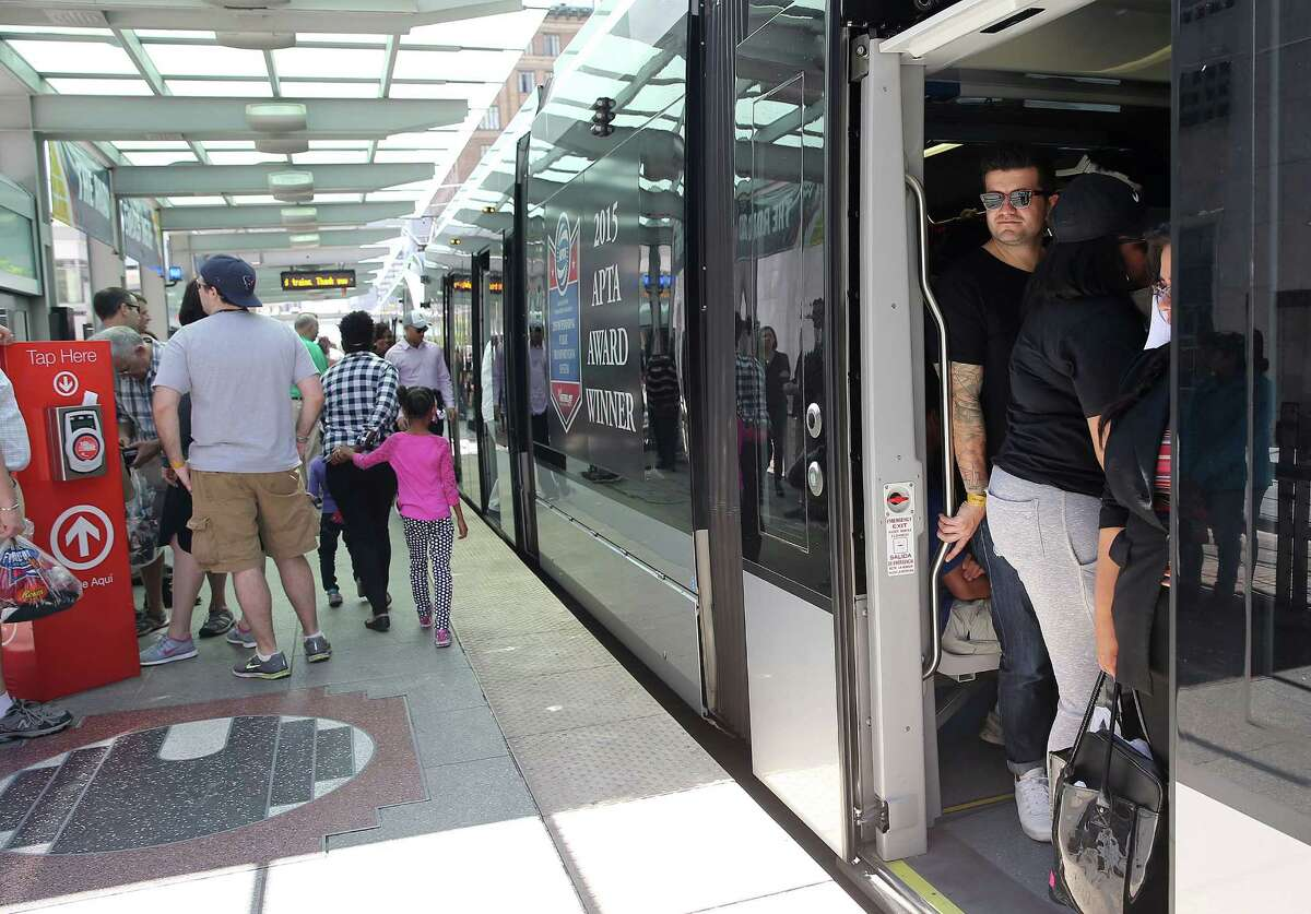 Basketball fans file into a Metro train from downtown to NRG Stadium on Saturday.