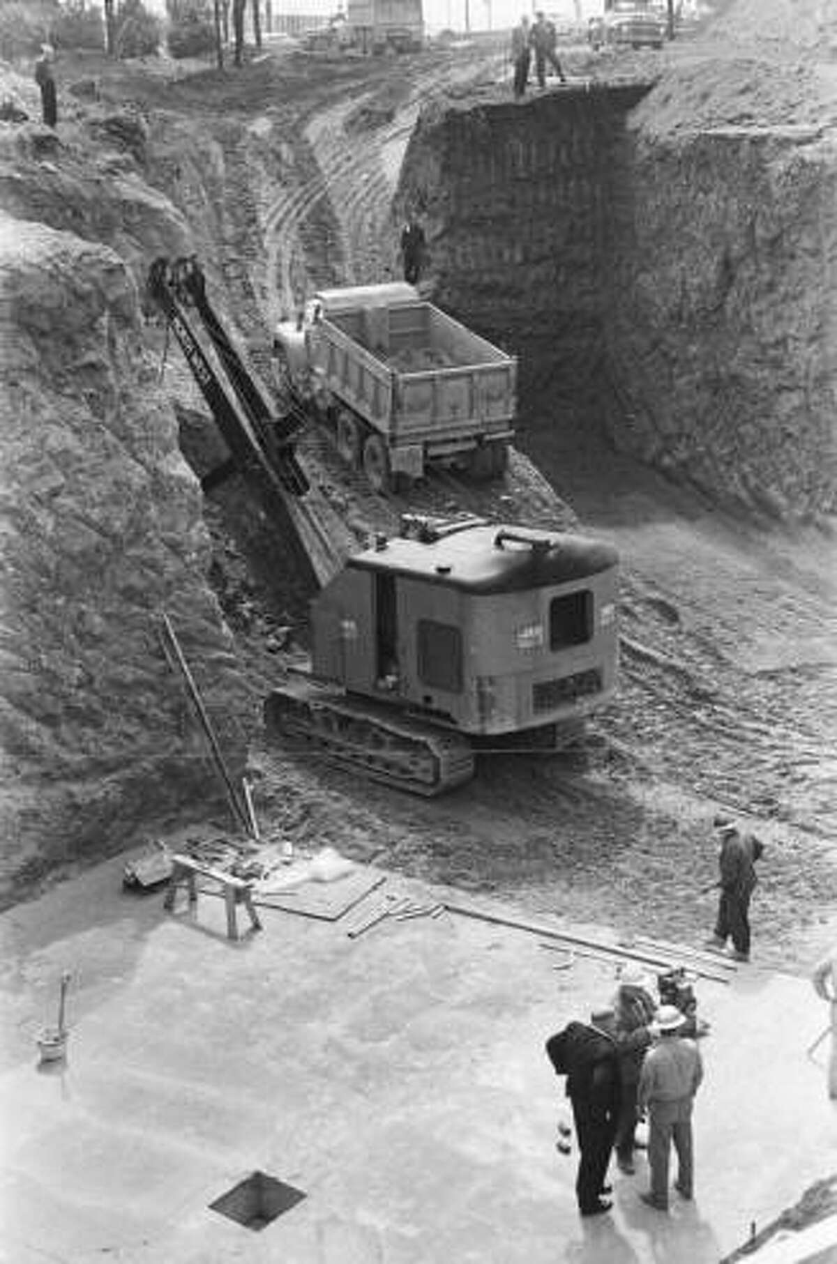 Here we can see workers excavating the Space Needle foundation, April 1961. Ironworkers were paid $3.92 an hour for this job.