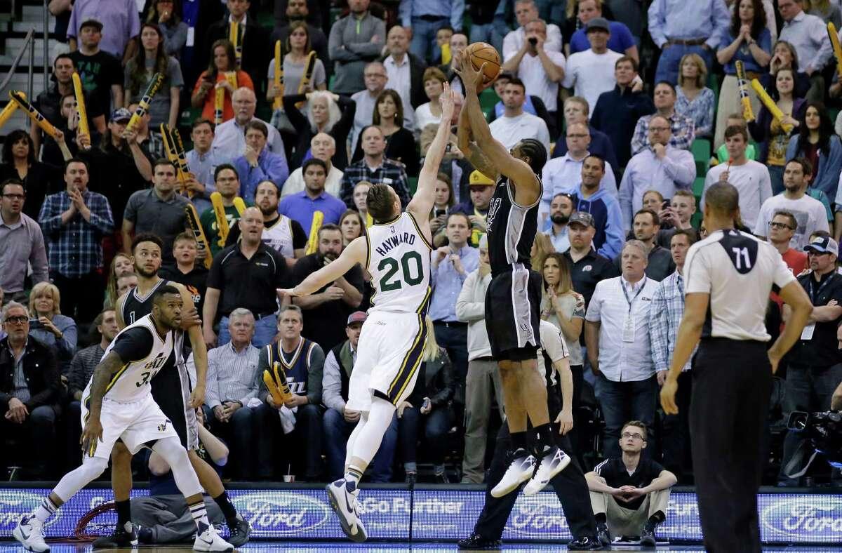 Spurs forward Kawhi Leonard shoots the go-ahead jumper against Utah Jazz forward Gordon Hayward on April 5, 2016, in Salt Lake City.