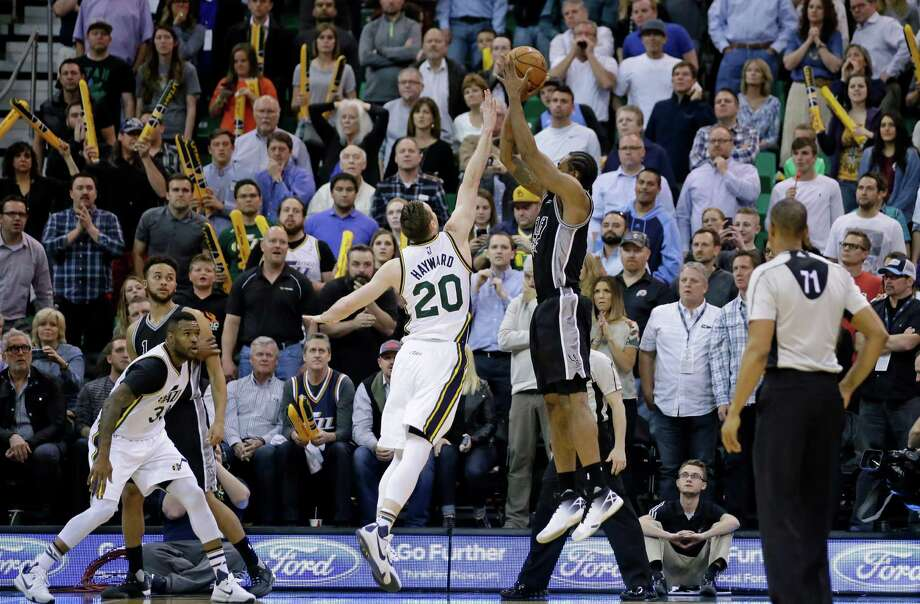 Spurs forward Kawhi Leonard shoots the go-ahead jumper against Utah Jazz forward Gordon Hayward on April 5, 2016, in Salt Lake City. Photo: Rick Bowmer /Associated Press / Copyright 2016 The Associated Press. All rights reserved. This material may not be published, broadcast, rewritten or redistribu