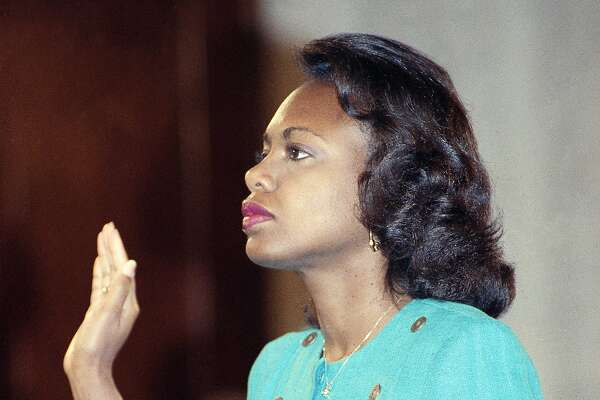 Anita Hill, then a law professor at the University of Oklahoma, is sworn in before her testimony in front of the Senate Judiciary Committee in 1991.